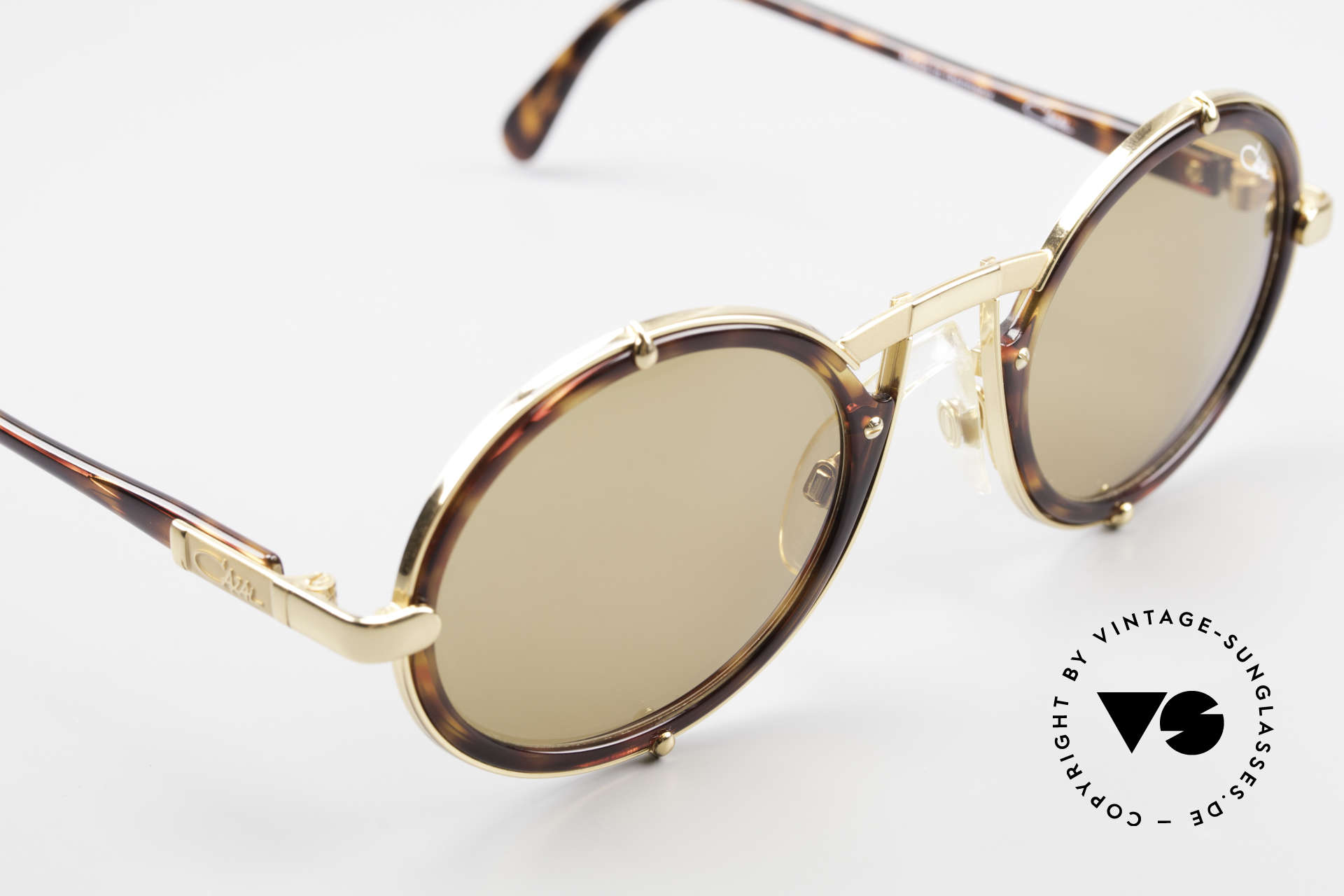 Cazal 644 Round Cazal 90's Sunglasses, unisex design with solid brown lenses (100% UV), Made for Men and Women