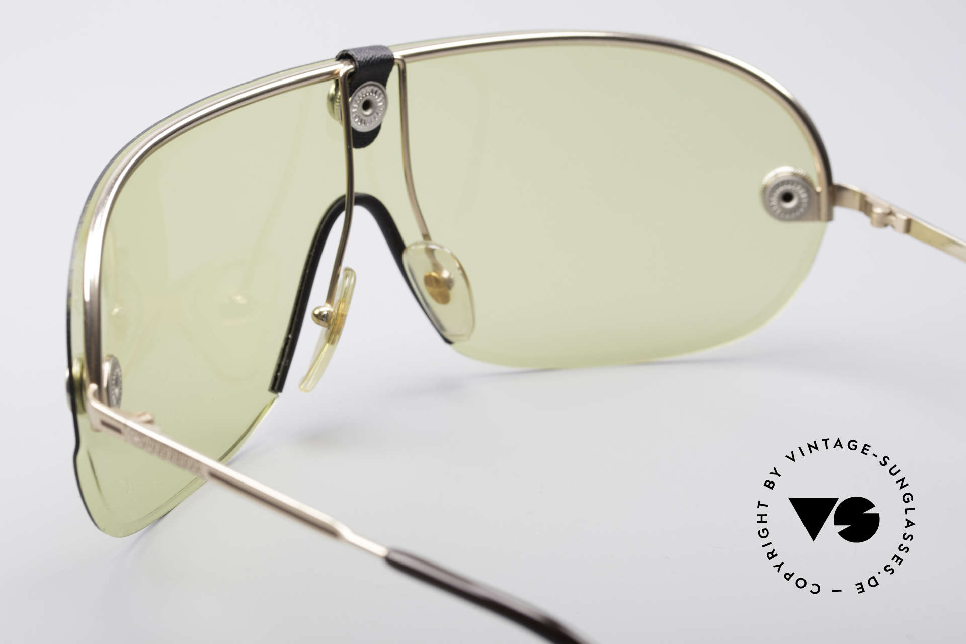 Carrera 5418 All Weather Sunglasses, yellow lens wearable at dusk and bown lens at daytime, Made for Men