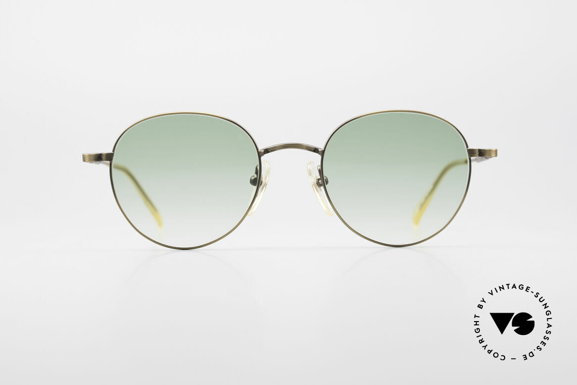 Jean Paul Gaultier 55-1174 Round Designer Sunglasses, costly, unique frame finish: METALLIC SMOKE GOLD, Made for Men and Women