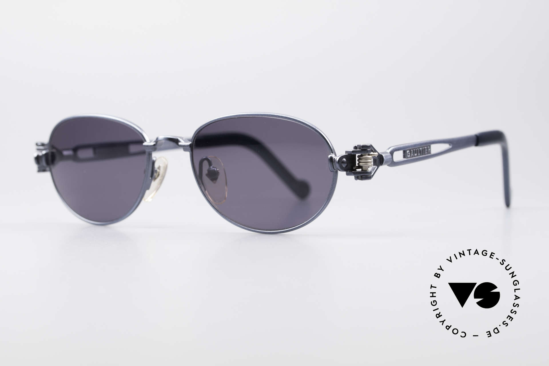 Jean Paul Gaultier 56-8102 Oval Industrial Sunglasses, frame with some mechanical components / details, Made for Men and Women