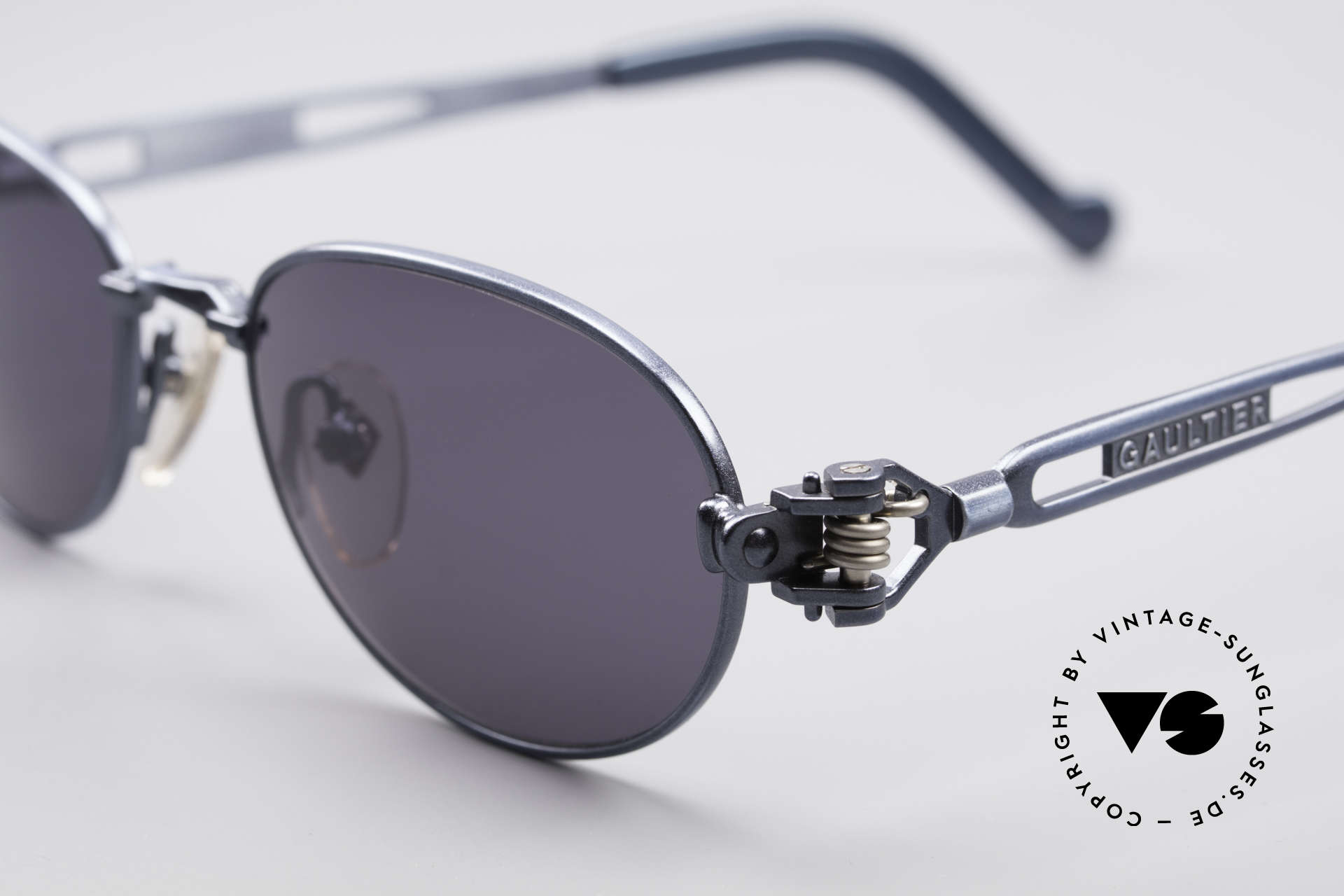 Jean Paul Gaultier 56-8102 Oval Industrial Sunglasses, blue-metallic and temple ends with a watch symbol, Made for Men and Women