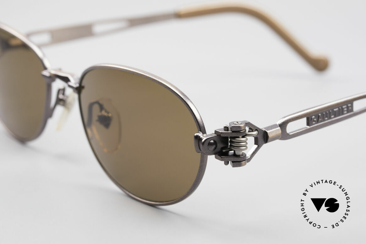 Jean Paul Gaultier 56-8102 Oval Steampunk Sunglasses, brownish-metallic; temple ends with a watch symbol, Made for Men and Women