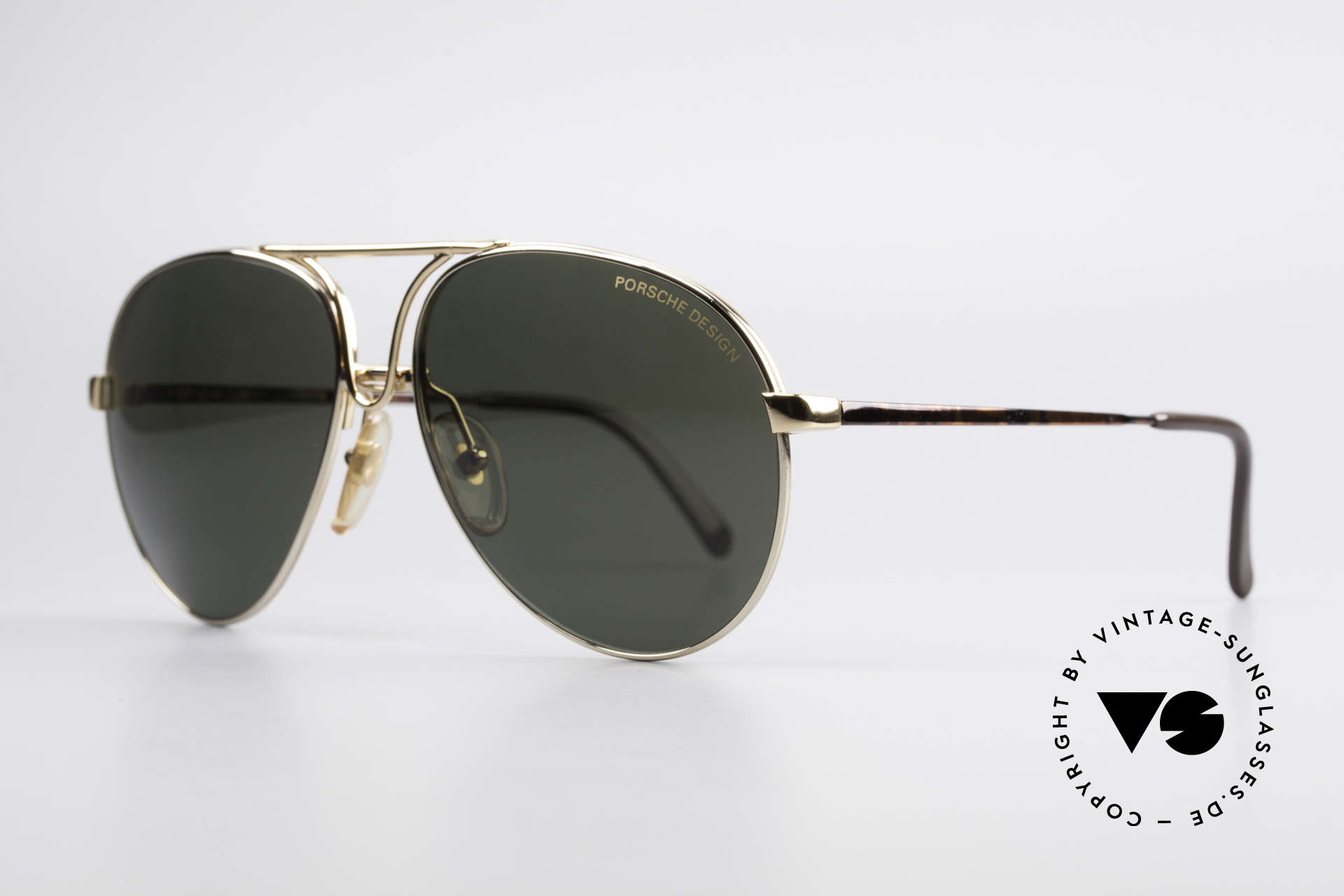 Porsche 5657 L Sunglasses With Two Fronts, 1x tortoise with demos & 1x gold with sun lenses, Made for Men