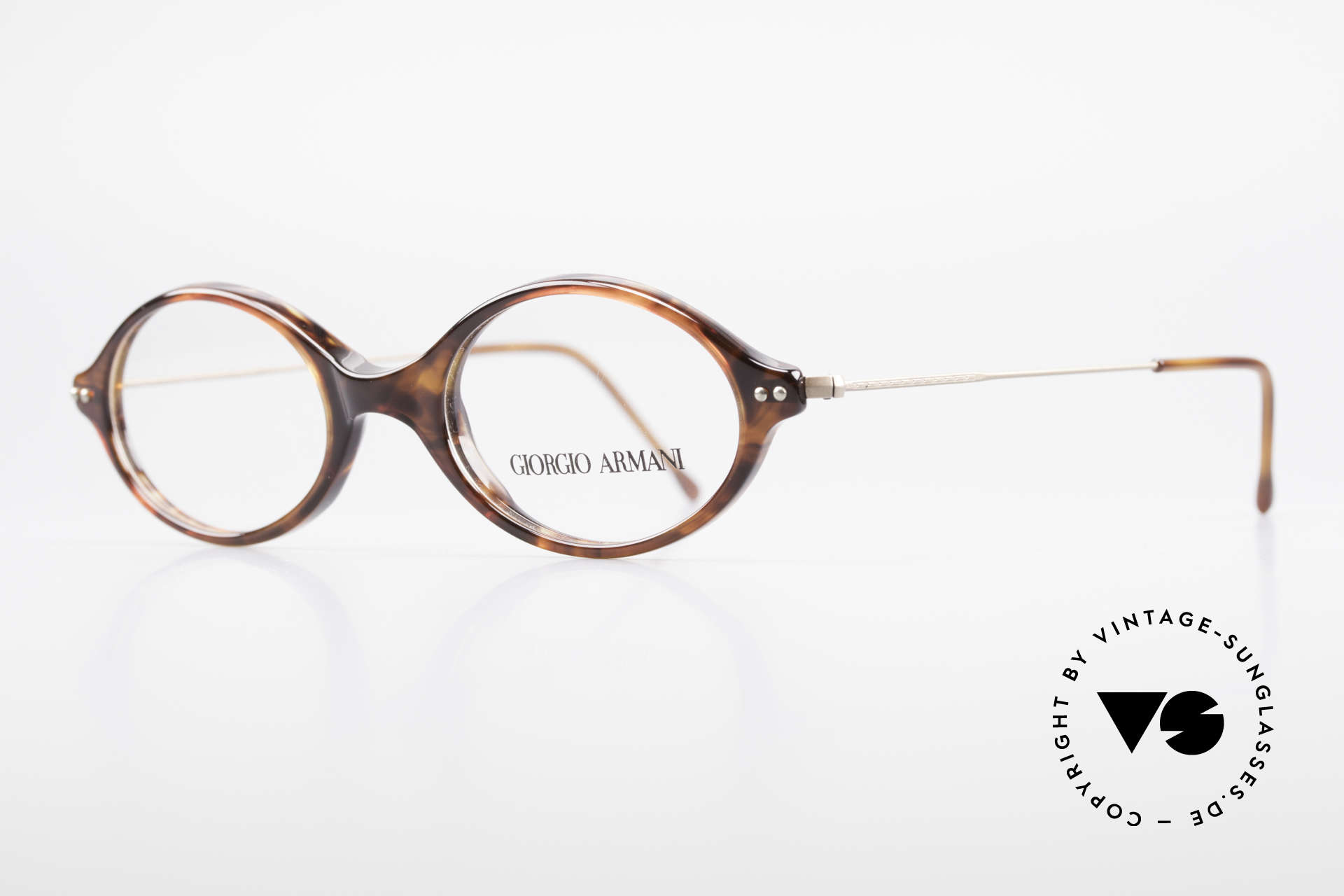 "Giorgio Armani 378 90's Unisex Eyeglasses Oval, lightweight plastic front with thin ""wire temples"", Made for Men and Women"