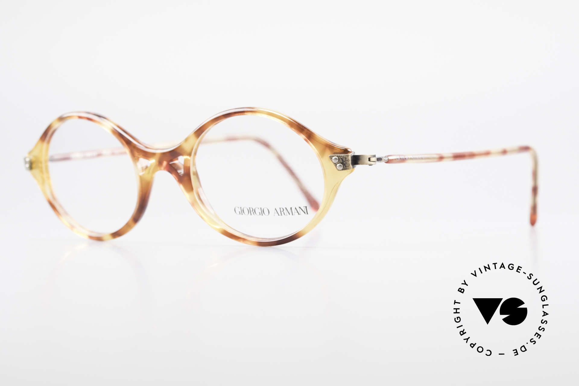 Giorgio Armani 339 Small Oval 90's Eyeglasses, tortoise frame with a striking bridge in TOP-quality, Made for Men and Women
