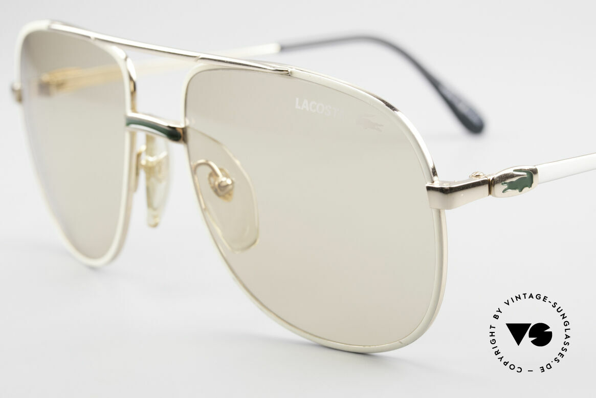 Lacoste 101 Lacoste Changeable Lenses, the lenses are lighter in the shade and darker in the sun, Made for Men