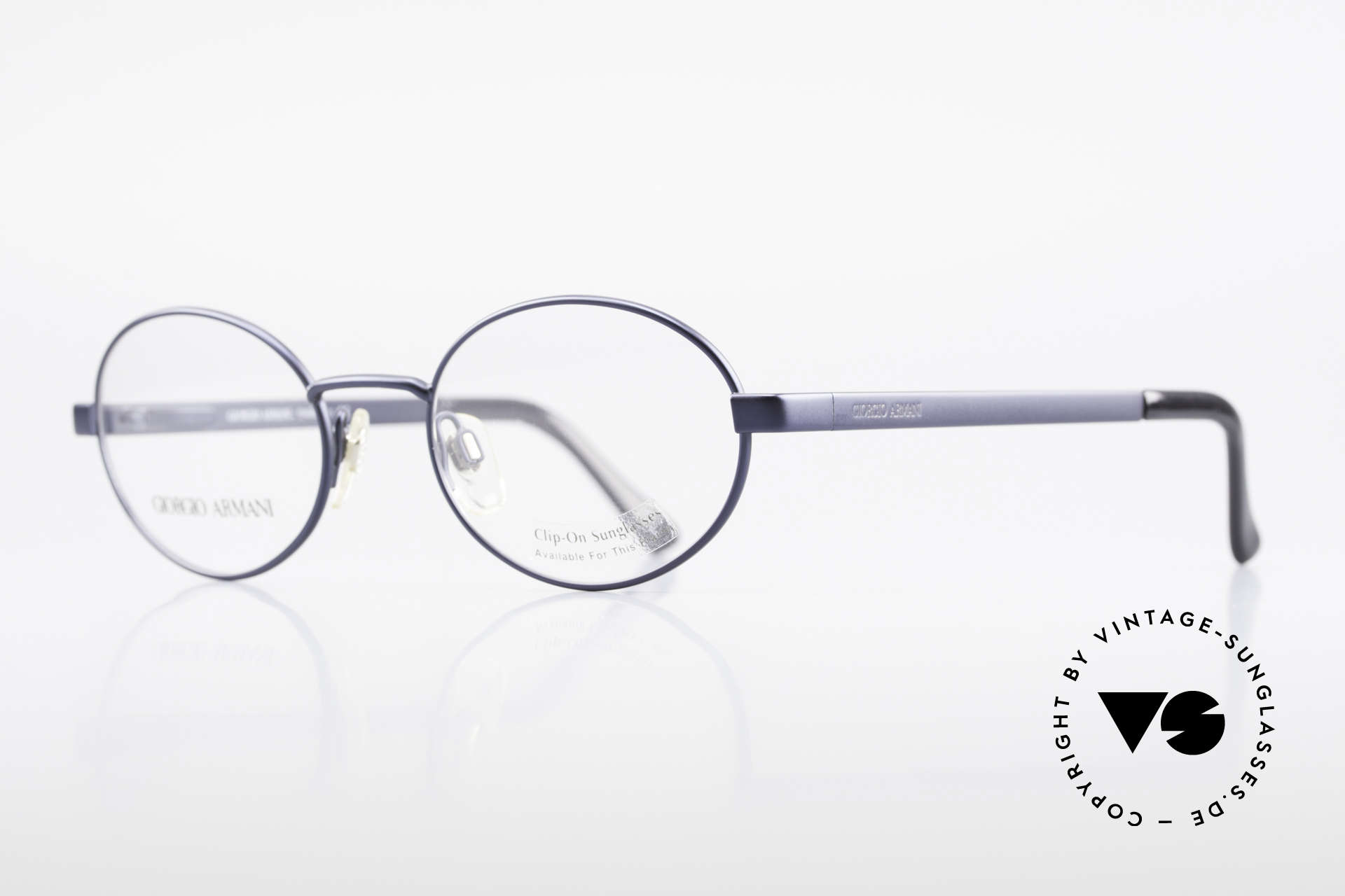 Giorgio Armani 257 90's Oval Vintage Eyeglasses, deep-blue frame finish and flexible spring hinges, Made for Men and Women