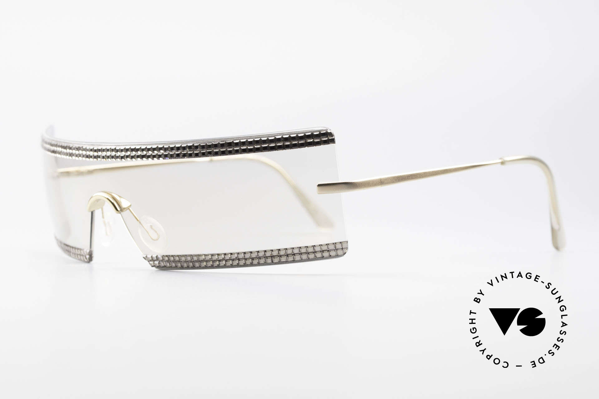 Swarovski S547 Glittering Shades Sunglasses, but this sunglass' model has elegance, style & charm, Made for Women