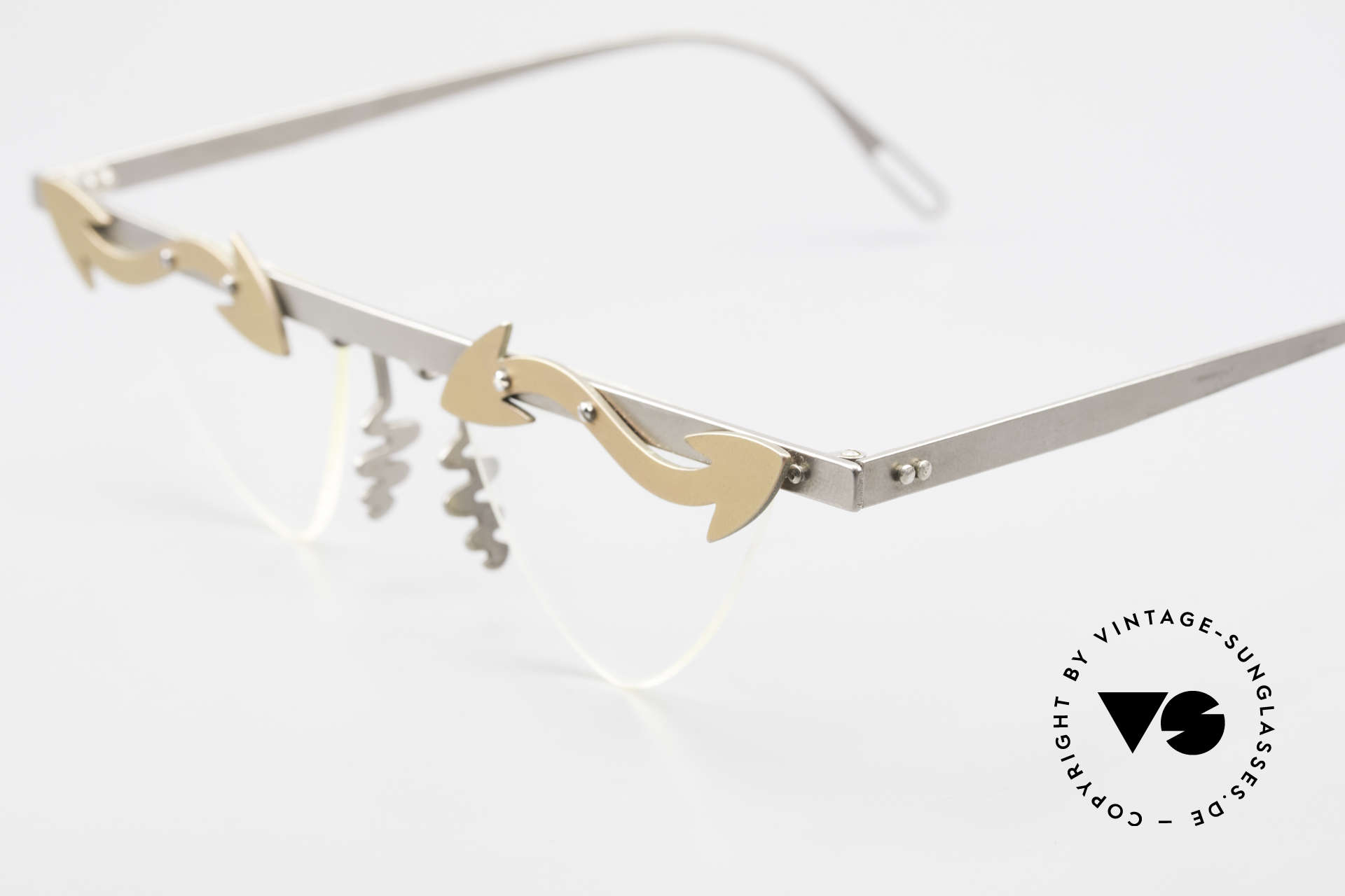 Theo Belgium Tita II Heart Shaped Eyeglasses Titan, the clear DEMO lenses are fixed with screws at the frame, Made for Women