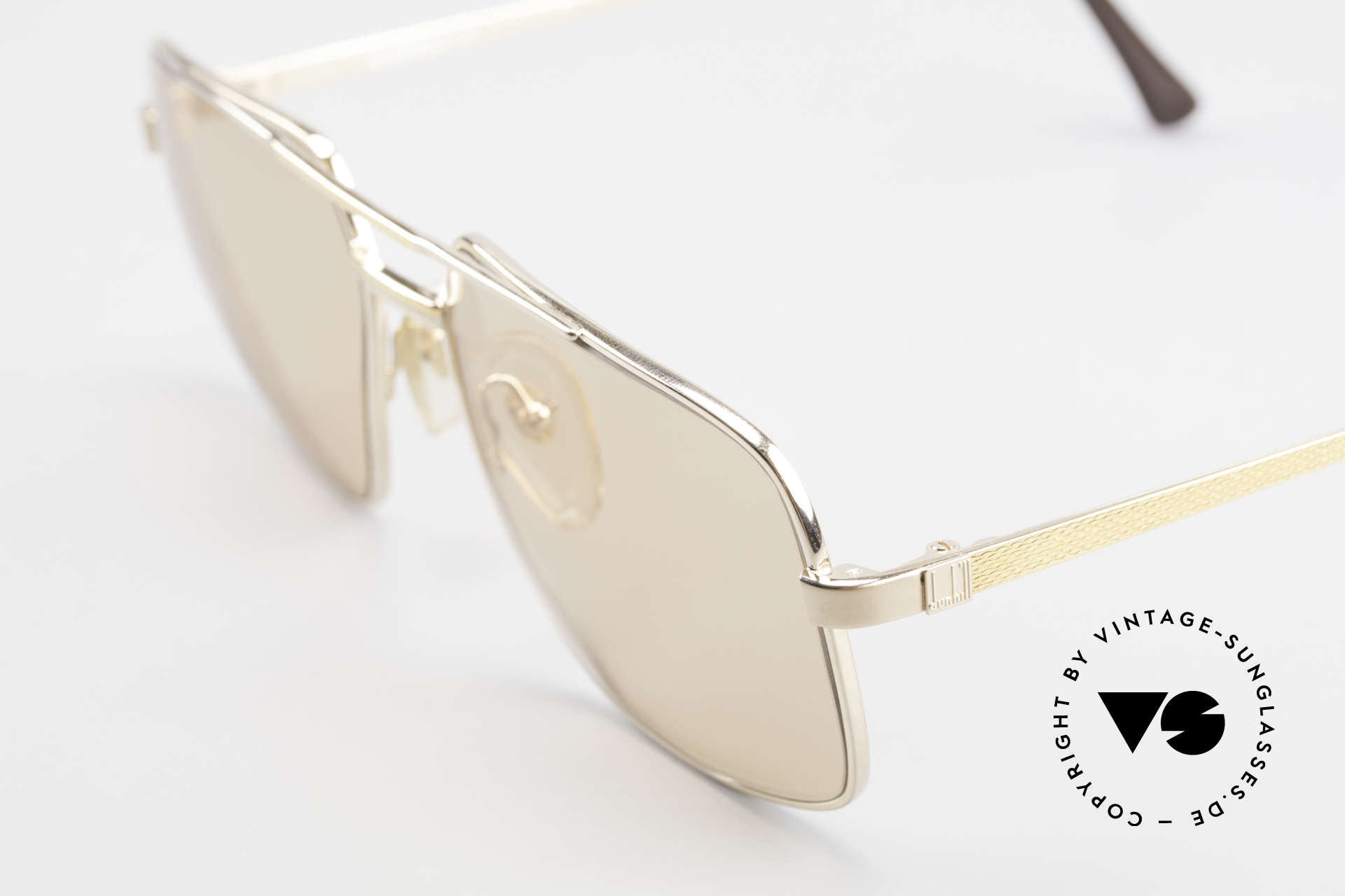 Dunhill 6068 Gold Plated Frame Changeable, changeable sun lenses (darken automatically in the sun), Made for Men