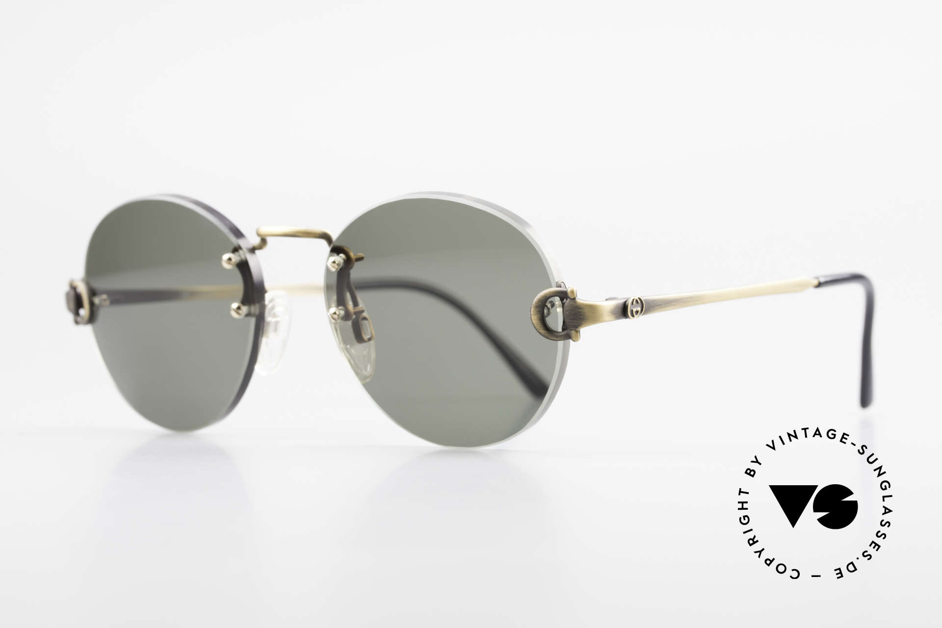 Gucci 2223 Rimless Round Sunglasses, thick, green sun lenses with brass bridge & temples, Made for Men and Women