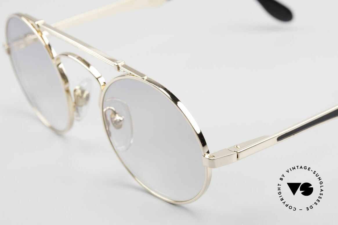 Bugatti 11711 Small Round Luxury Sunglasses, with light gray-gradient lenses (anytime wearable), Made for Men