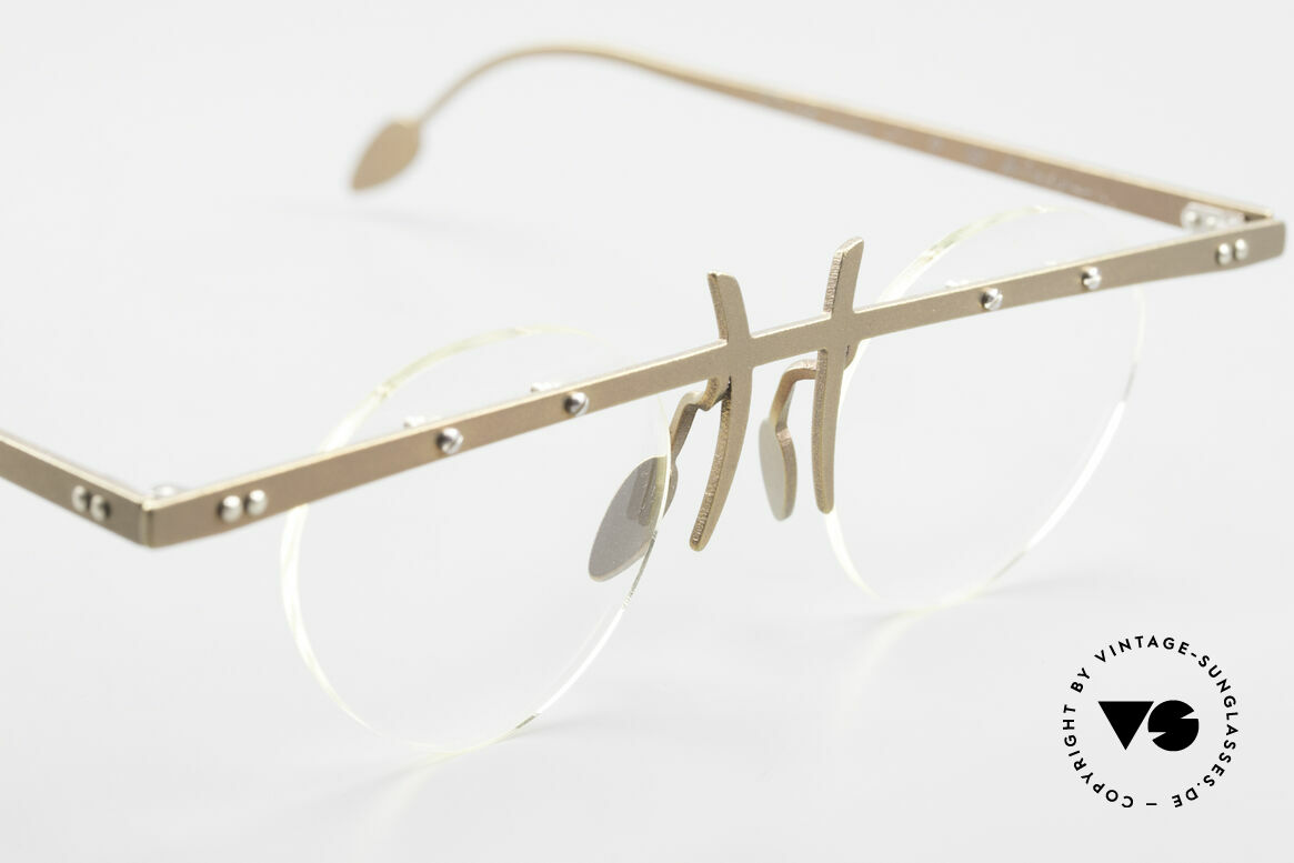 Theo Belgium Tita VI 9 Vintage Eyeglasses Titanium, the clear DEMO lenses are fixed with screws at the frame, Made for Men and Women