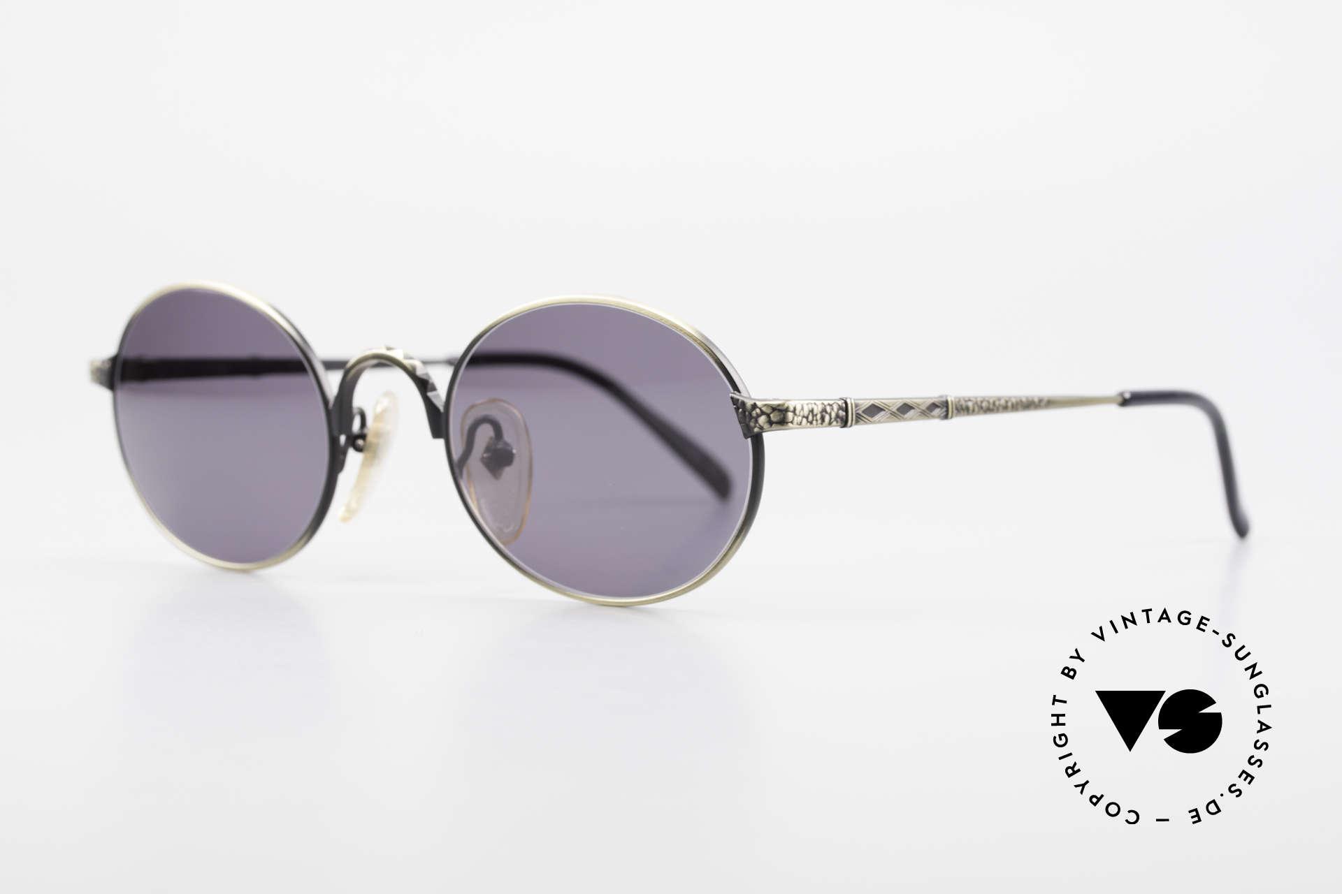 Jean Paul Gaultier 55-9672 Oval 1990's JPG Sunglasses, 'smoke gold' finish and dark-gray sun lenses, Made for Men and Women