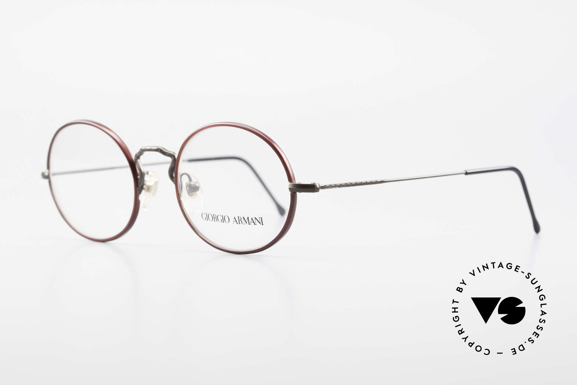 Giorgio Armani 247 Oval 90's Eyeglasses No Retro, frame with subtle engravings & ruby-colored rings, Made for Men and Women