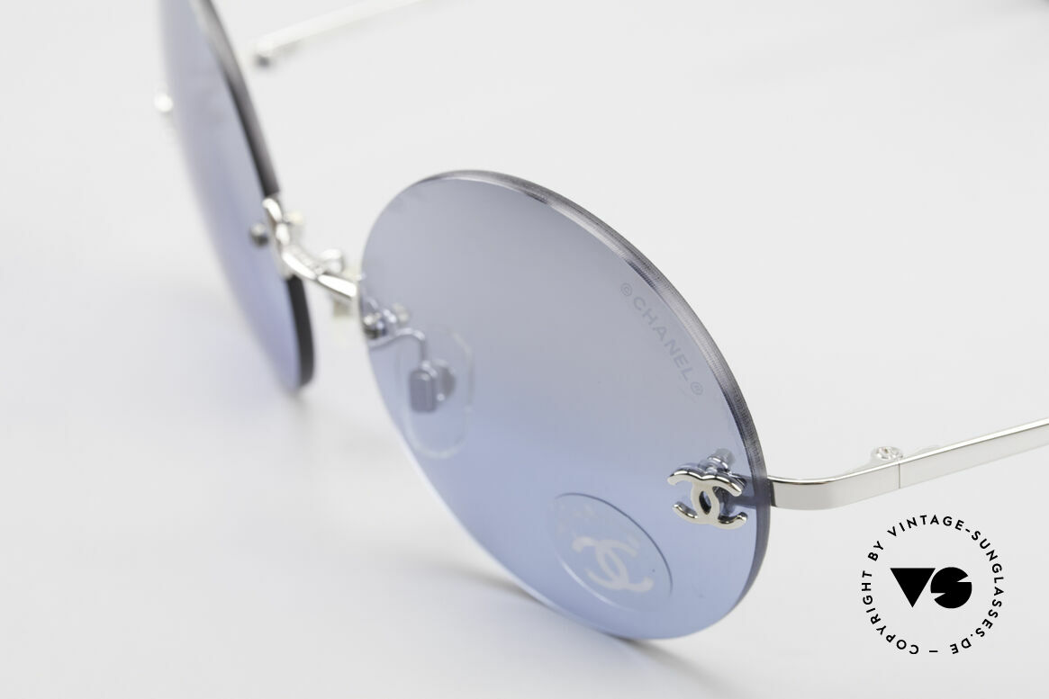 Chanel 4056 Round Luxury Shades Rimless, blue sun lenses are light-mirrored; 100% UV protection, Made for Men and Women
