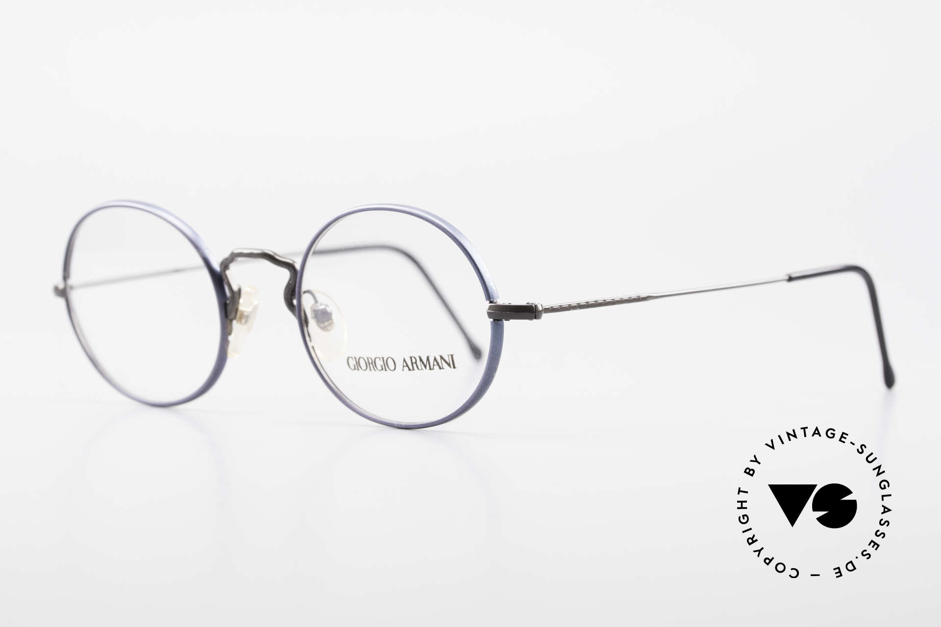 Giorgio Armani 247 No Retro Eyeglasses 90's Oval, frame with subtle engravings & with dark blue rings, Made for Men and Women