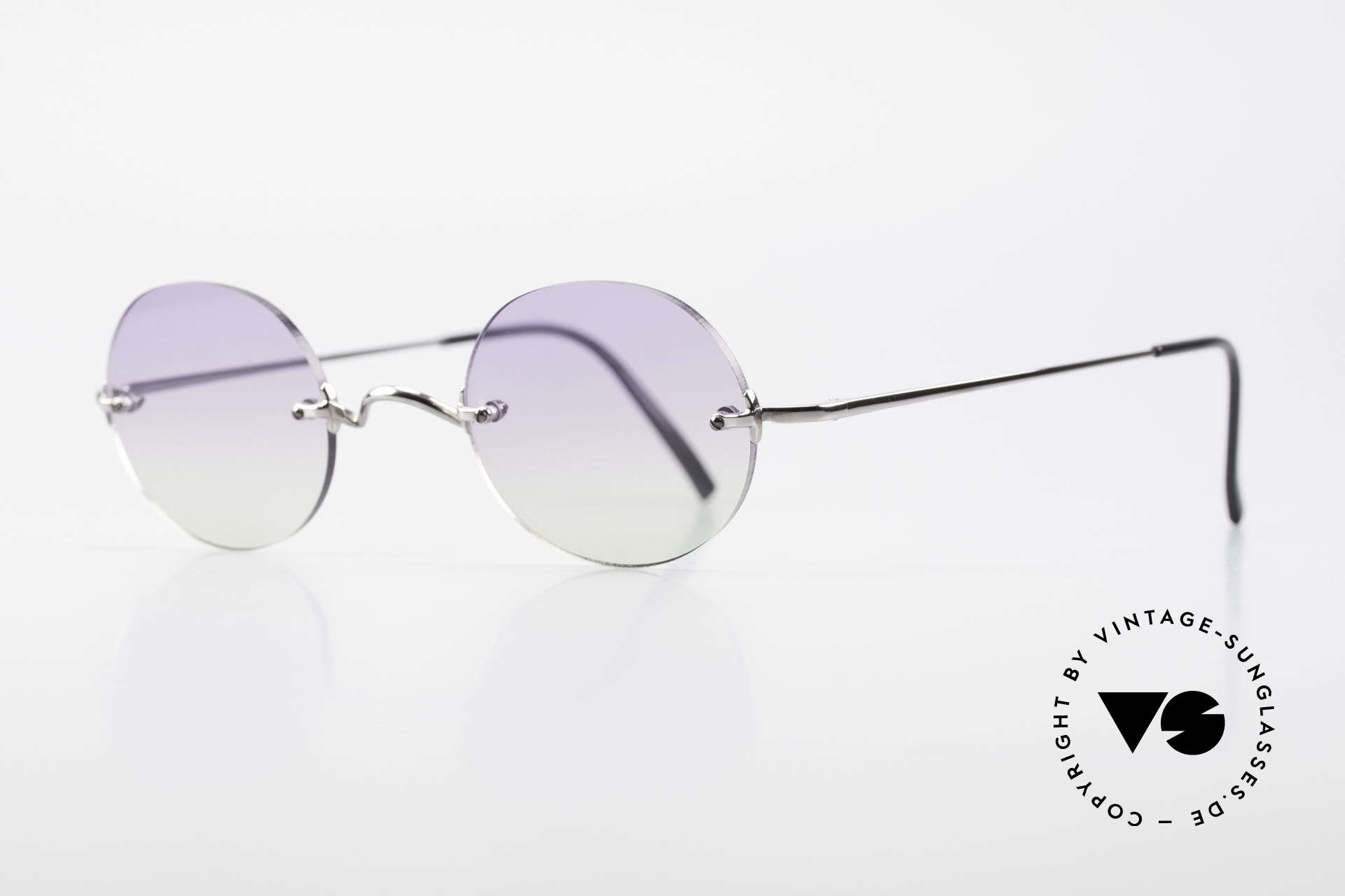 Freudenhaus Flemming Round Rimless Sunglasses, silver/chrome metal components are made in Japan, Made for Men and Women