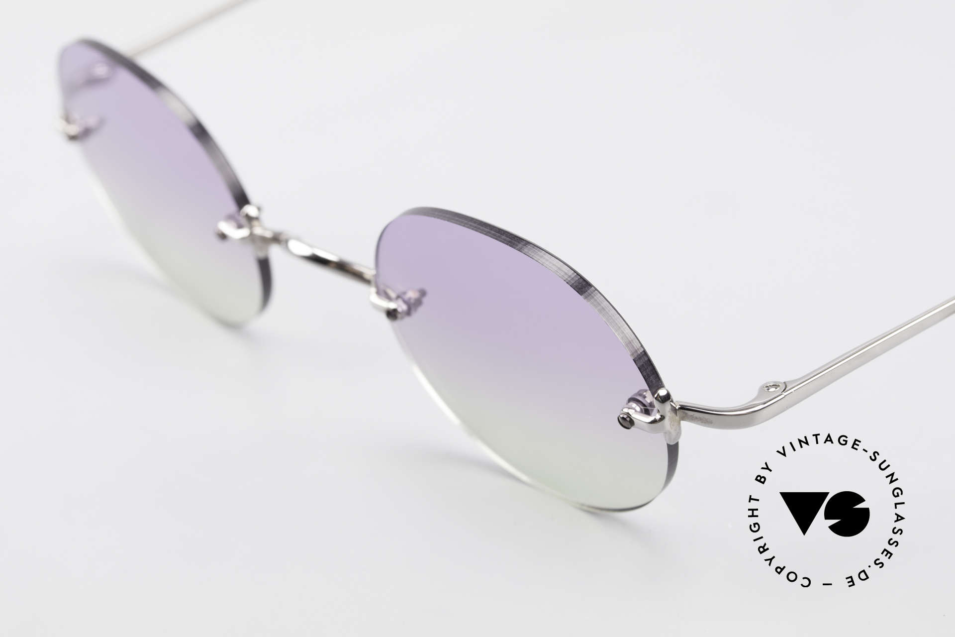Freudenhaus Flemming Round Rimless Sunglasses, bicolored gradient sun lenses (from purple to green), Made for Men and Women