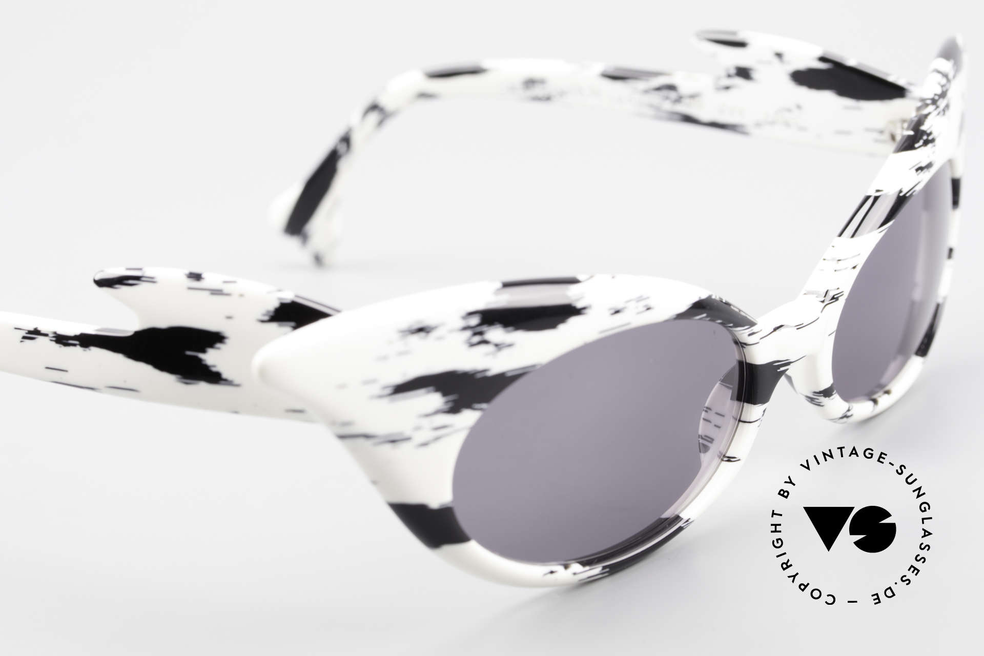 Alain Mikli D309 / 2105 Limited Edition 101 Dalmatians, with dark gray CR39 sun lenses for 100% UV protection, Made for Women