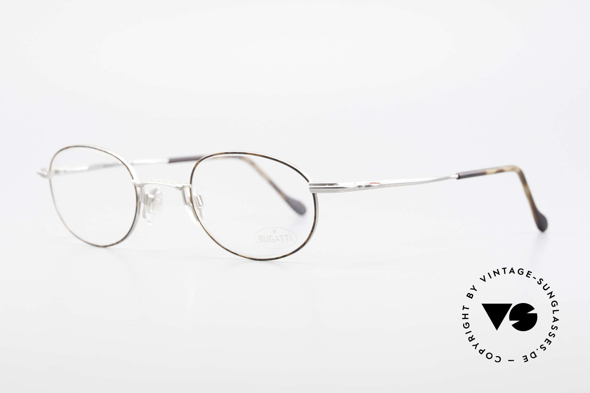 Bugatti 23547 Rare 90's Titanium Eyeglasses, ergonomic temples and nose pad for a 1st class comfort, Made for Men and Women