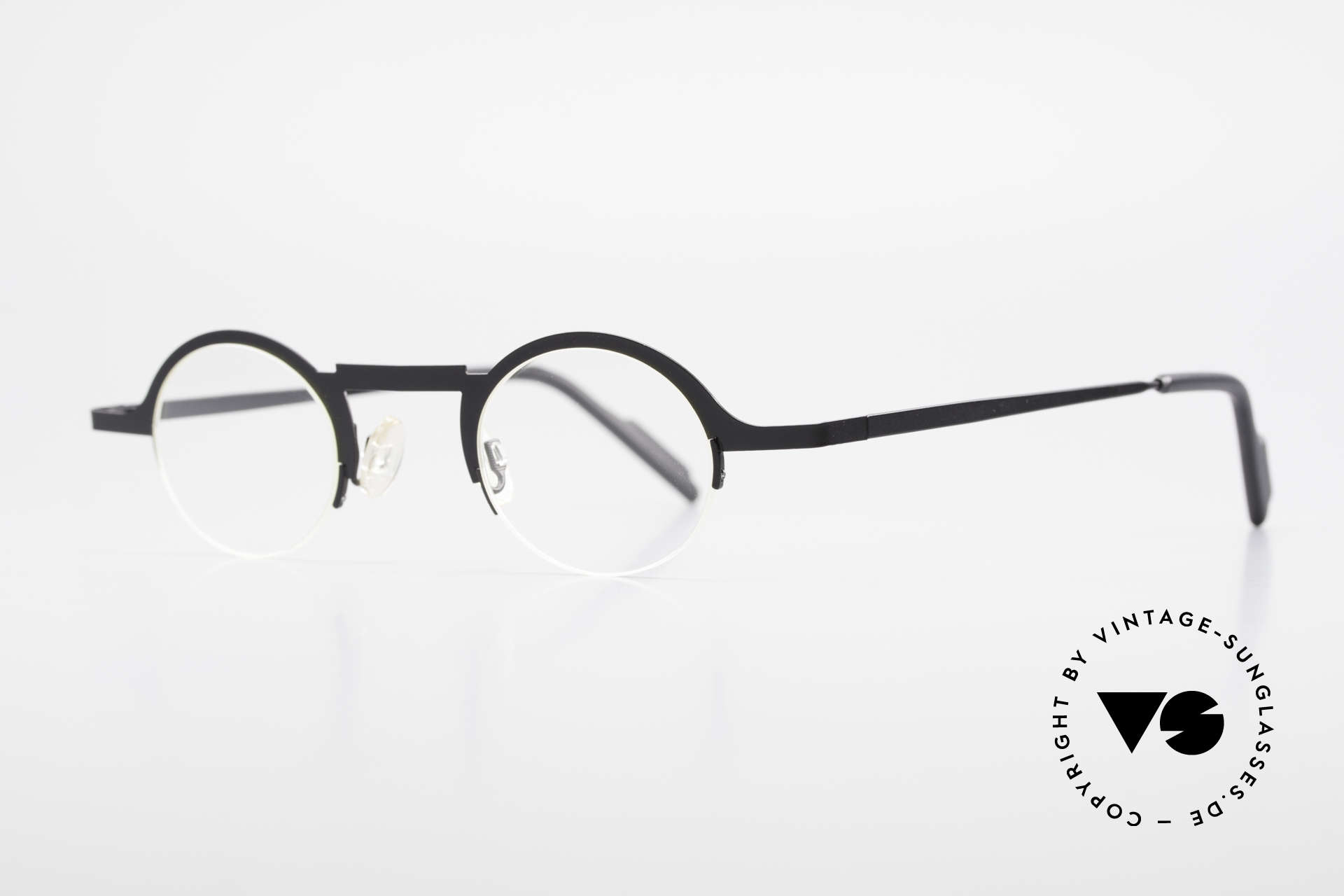 Theo Belgium Triptrio Round Designer Eyeglasses, round frame design; semi rimless, dulled black finish, Made for Men and Women