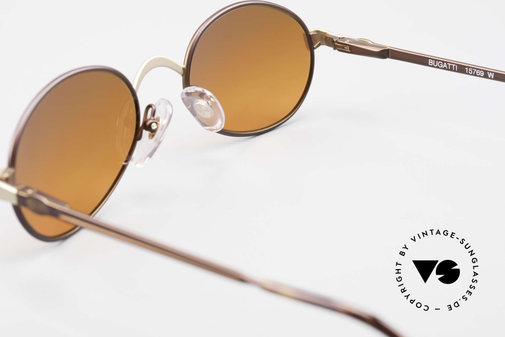 Bugatti 15769 Bronze Brown Metallic Frame, the fancy SUNSET sun lenses can be replaced optionally, Made for Men and Women