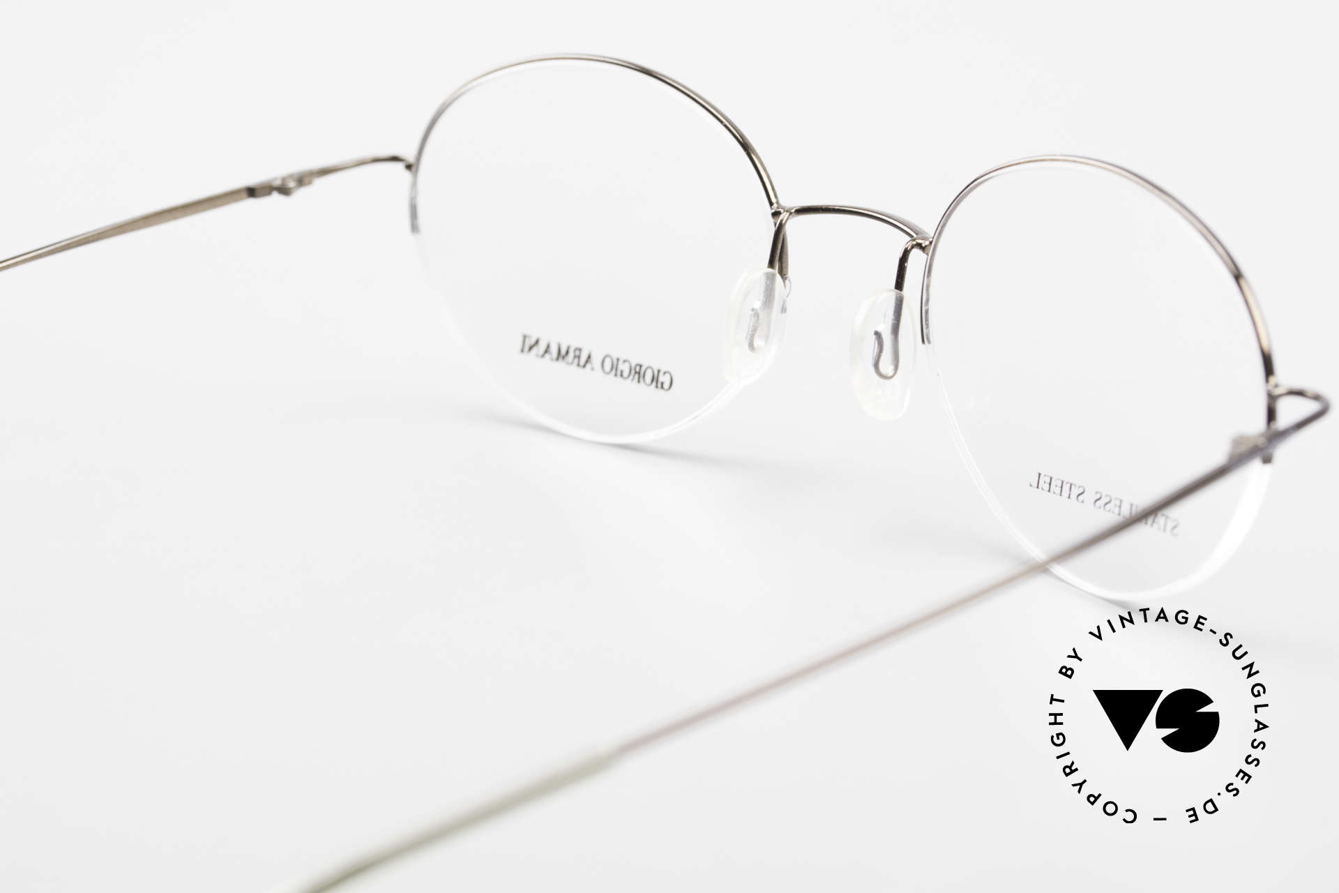 Giorgio Armani 27N Small Round Eyeglasses Nylor, semi rimless = lenses are fixed with a Nylor thread, Made for Men and Women