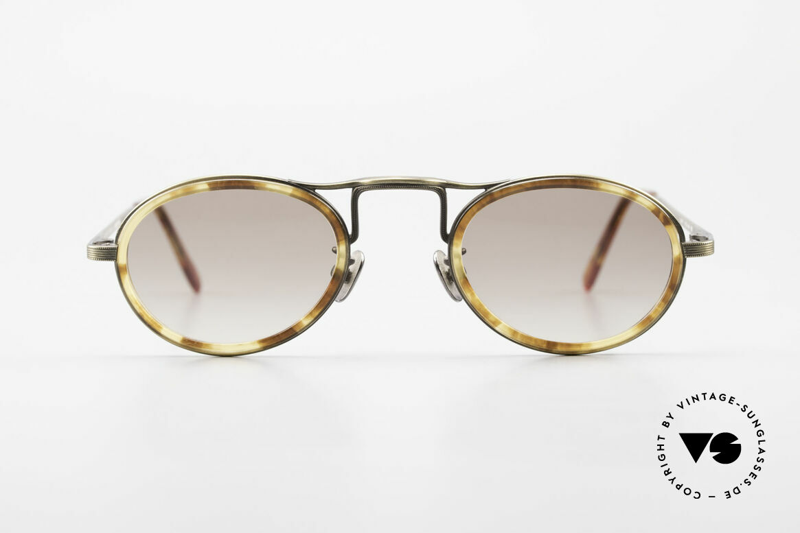 Oliver Peoples MP1 Vintage Designer Frame Oval, vintage Oliver Peoples sunglasses from the late 1990's, Made for Men and Women