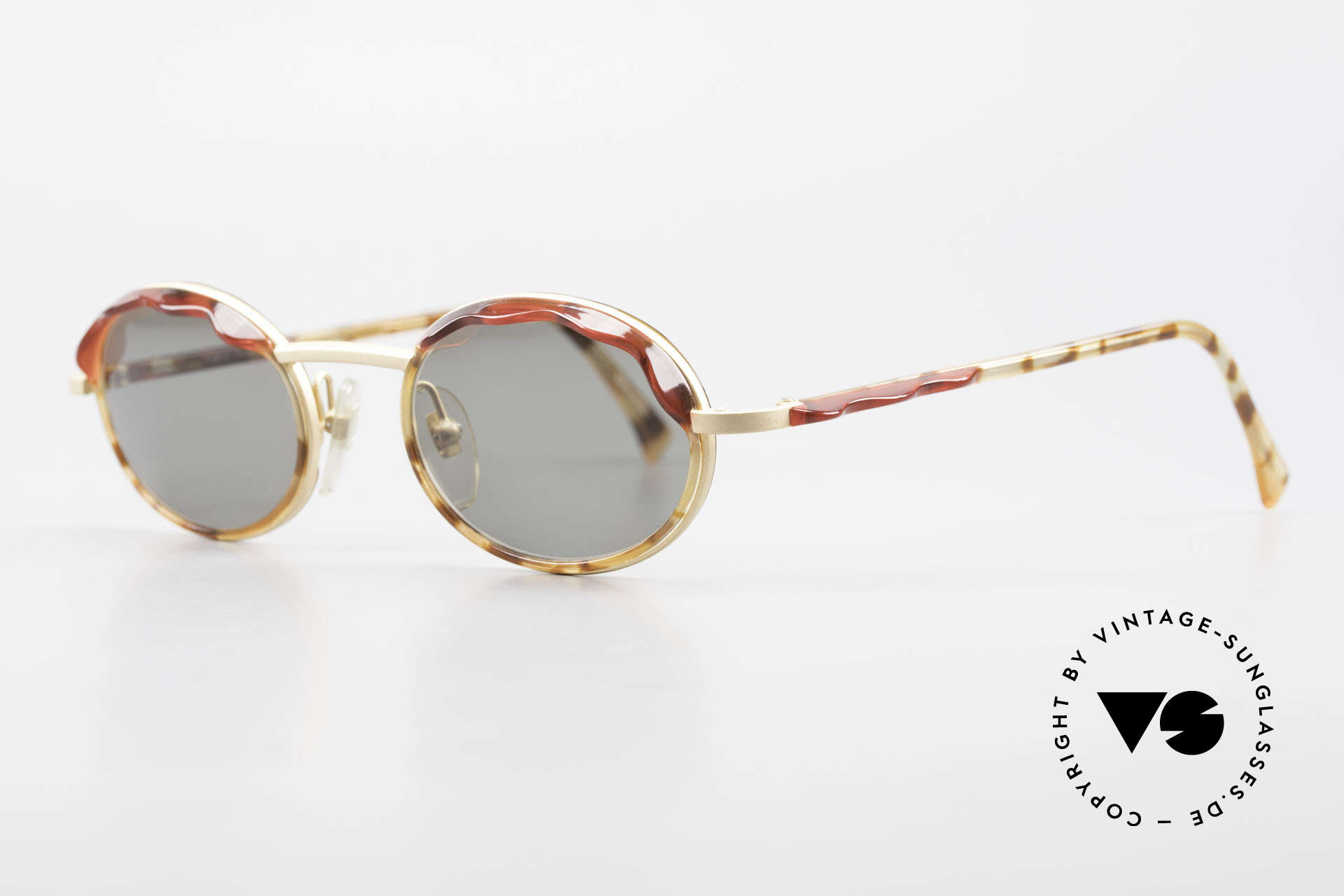 Alain Mikli 2149 / 04001 Oval Vintage Ladies Shades, with small red sun shields (blinds) above the lenses, Made for Women