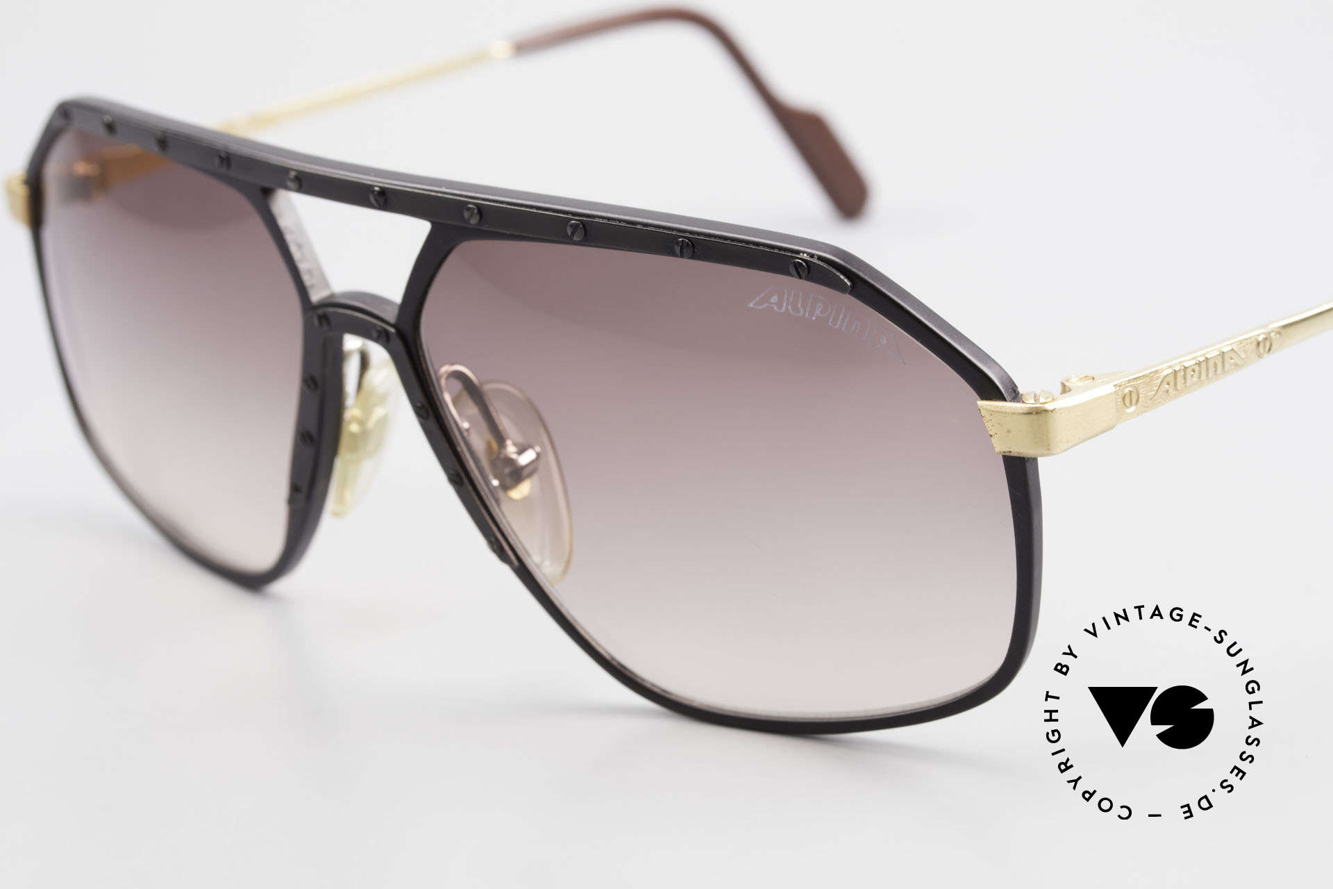 Alpina M6 Rare Vintage 80's Sunglasses, black/gold: black screws & black ornamental cover, Made for Men and Women